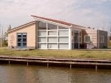 Workum holiday bungalow rental - Waterfront home in Friesland, Netherlands